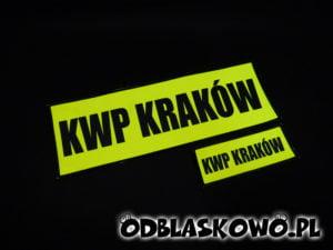 Naszywka odblaskowa KWP Kraków na żółtym tle czarny napis