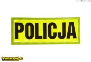 Emblemat odblask napis policja na żółtym tle