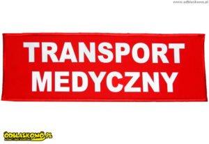 Emblemat odblask z napisem transport medyczny na czerwonym tle