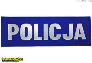 Emblemat odblaskowy na niebieskim tle napis policja