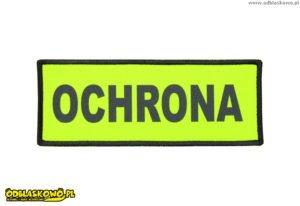 Napis ochrona na odblaskowym emblemacie żółtym