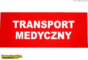 Napis transport medyczny na czerwonym tle