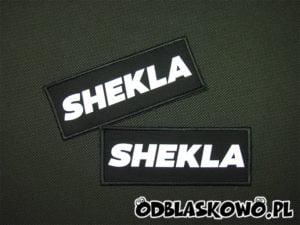 Czarne tło naszywki shekla