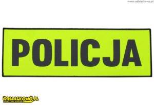 Policja na żółtym tle emblematu odblaskowego