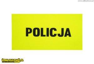 Żółte tło naszywki odblaskowe z napisem policja